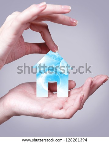 the home of your dreams in your hands - stock photo