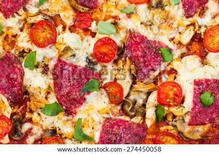 The Home Pizza. made with fresh tomatoes, salami, chicken, mushrooms, onion, tomato sauce, mozzarella and basil leaves background , texture - stock photo
