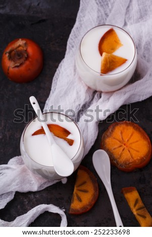 The homemade yogurt in a glass of persimmon - stock photo