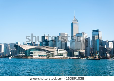 The Hong Kong skyline from across Victoria Harbor. - stock photo