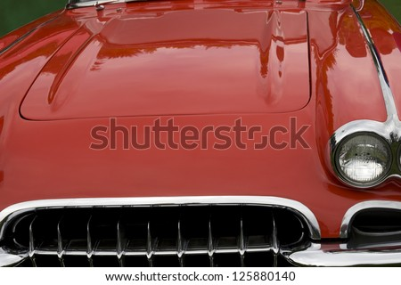 the hood of a classic red sports car - stock photo