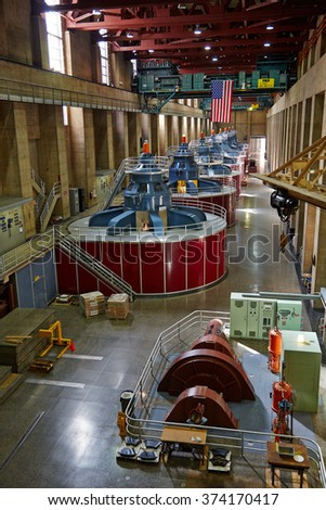 The Hoover dam, USA - December, 2013: hall engine room with turbines.