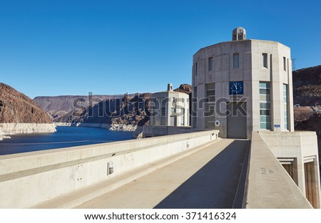 The Hoover dam, water tower, river and mountains, USA - stock photo