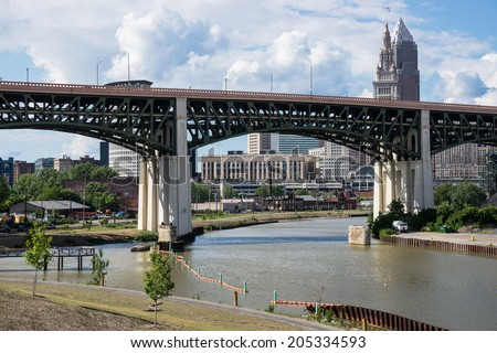 The Hope Memorial Bridge that spans the Cuyahoga River with a portion of the downtown Cleveland business district in the background seen from the Scranton Flats Towpath recreation area