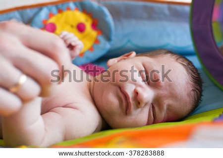 The horizontal portrait of the crying little baby - stock photo