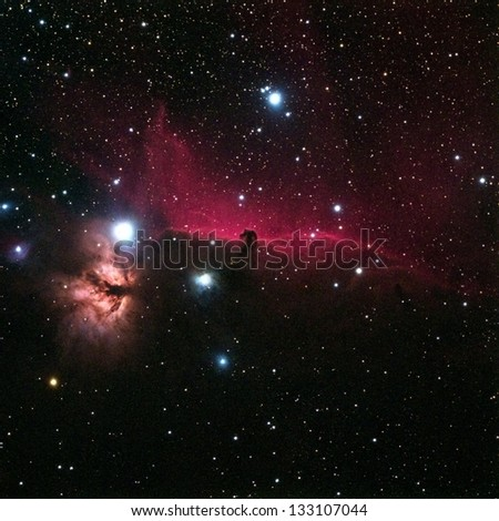 The horse head is an area of dust masking an emission nebula running from north to south by the star Alnitak in the belt of the constellation Orion. - stock photo