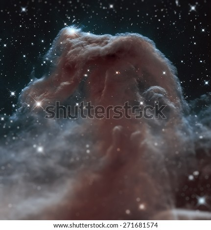 The Horsehead Nebula is a dense cloud of gas and dust embedded in a much larger structure. Infrared view. Elements of this image furnished by NASA. - stock photo