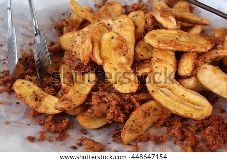 The hot banana fried.Delicious snacks bananas fried in hot oil.  - stock photo