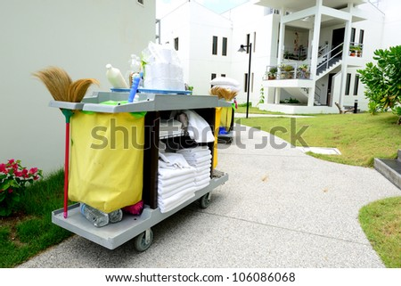The hotel cleaning tool cart of housekeeper are on the walkway of resort area - stock photo