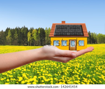 The house in hands - stock photo