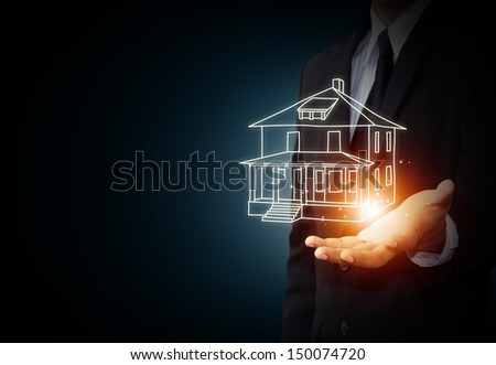 The house in human hands, insurance concept - stock photo