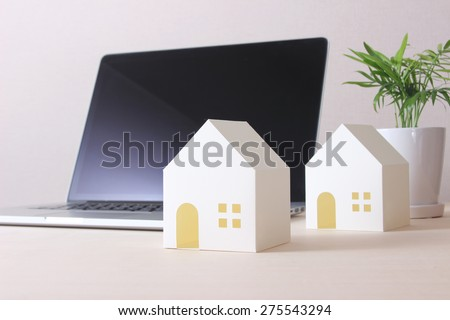 the house of paper and a laptop - stock photo