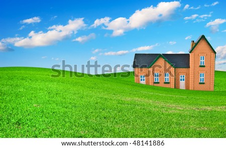 The house on a grass under the dark blue sky