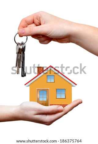 The house with keys in hands isolated on white background