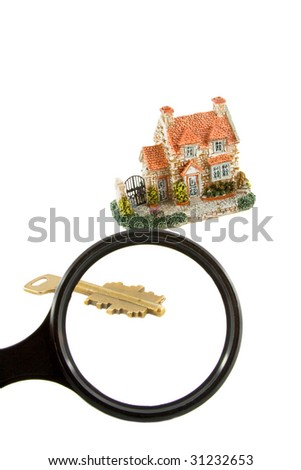 The house with keys.View through a magnifier