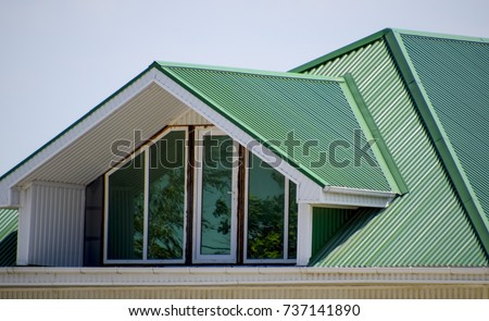 House plastic windows green roof corrugated stock photo 700358404 the house with plastic windows and a green roof of corrugated sheet roofing of metal sciox Images