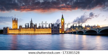 The houses of Parliament and Westminster Bridge under a sunset sky - stock photo