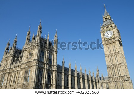 The Houses of Parliament at Westminster Palace and Big Ben shine in bright morning sun in London, UK - stock photo