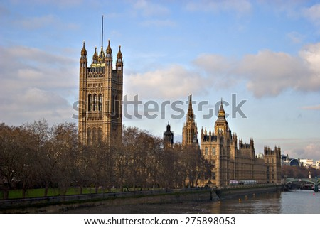 The Houses of Parliament in London, England, standing alongside the River Thames