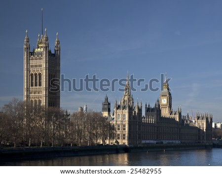 The Houses of Parliament (Westminster Palace) seen from Lambeth Bridge during the afternoon - stock photo