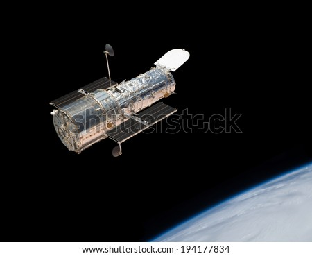 The Hubble Space Telescope in orbit above the Earth. Elements of this image furnished by NASA.  - stock photo