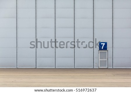 The huge gate of hangar and a small door