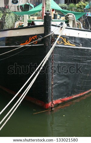 The hull of an old wooden boat - stock photo