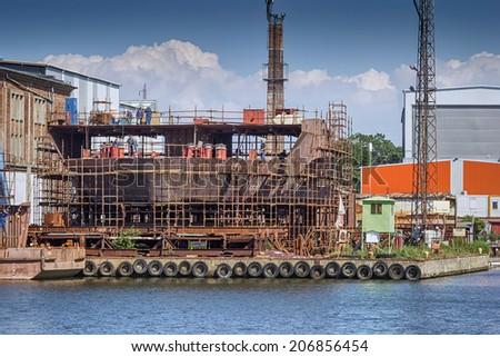 The hull ship built at the yard - stock photo