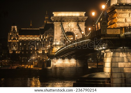 The hungarian Chain Bridge and the Gresham palace on the bank of the Danube river in decorative night lights, Budapest, Hungary - stock photo
