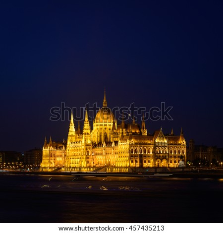 The Hungarian Parliament Building close to Danube river at night.