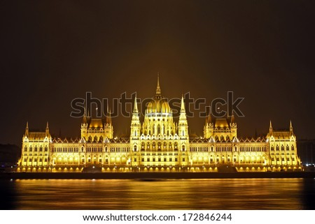 The Hungarian Parliament Building National Assembly of Hungary night shoot - Famous tourist attraction of Hungary by  the river Danube - stock photo