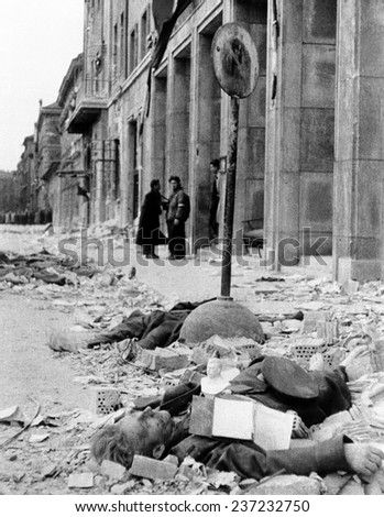 The 1956 Hungarian Uprising A dead Russian uniformed soldier in the rubble on a Budapest street Oct. - stock photo