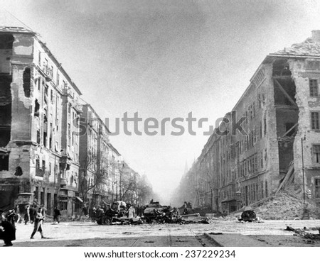 The 1956 Hungarian Uprising A destroyed Russian tank and other vehicles in front of the Soviet Kilian Barracks at Francis Boulevard Budapest. - stock photo