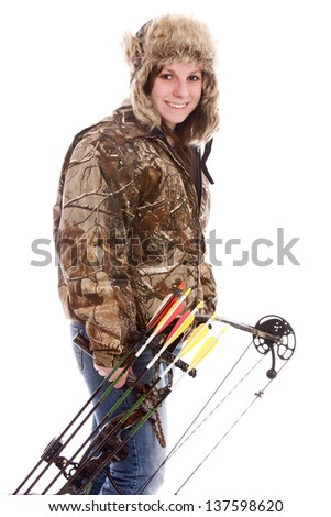 The Hunter.  Attractive teen girl with bow & arrows and dressed in camo.  Isolated on white. - stock photo