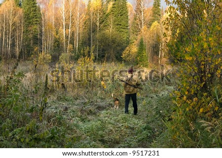 The hunter with the hunting dog leaves on hunting - stock photo
