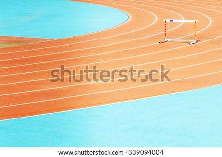 The hurdle on stadium running tracks. - stock photo