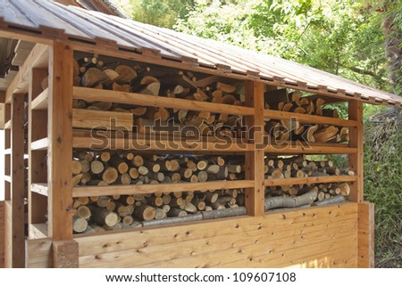 The hut which keeps firewood - stock photo