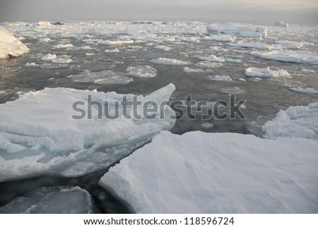 The ice around the Antarctic islands winter day. - stock photo