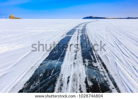The ice road over Baikal lake in winter near Olkhon island, Irkutsk, Siberia, Russia.
