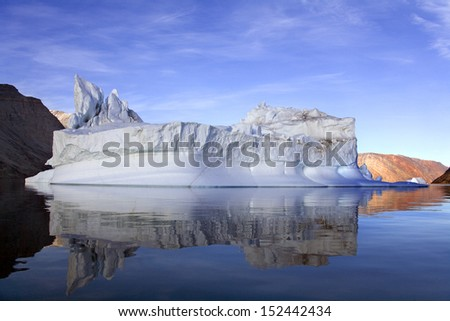 The 'Iceberg graveyard' in Franz Joseph Fjord in eastern Greenland - stock photo
