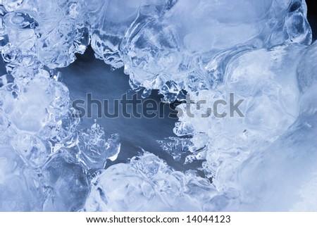 The icebound stream in blue tone - stock photo