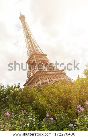 The iconic Eiffel Tower in Paris, a cultural French landmark and mionument orignally designed by Gustave Eiffel for the 1899 World Fair and now classed as a global tourist destination, tilted angle - stock photo