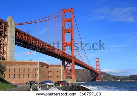 The iconic Golden Gate Bridge and Fort Point, viewed from the southern end. - stock photo