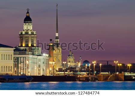 The iconic view of St. Petersburg White Night - Curiosities, Vasilievsky Island with Rostral columns, Peter and Paul Fortress and mosque in one shot. Russia - stock photo
