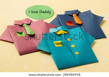 The idea of design for Father's day: shirts from paper technique origami and the words: I love daddy - stock photo