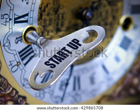 The idea starts a business as a key starts the clock Concept  - with shallow depth of field - stock photo