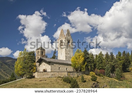 The idyllic San Gian church on a hill east of Celerina is the symbol of the whole region - stock photo
