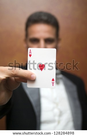 The illusionist performing with card - stock photo