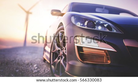 The image in front of the sports car scene behind as the sun going down with wind turbines in the back.
