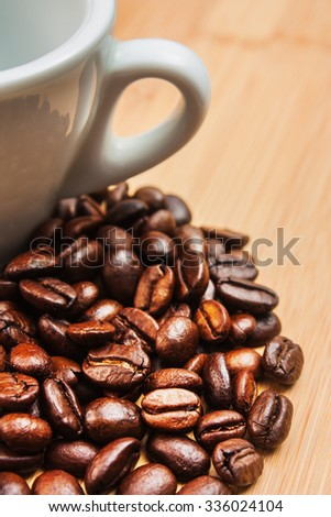 The image is laid out coffee beans on the background of the old board - stock photo